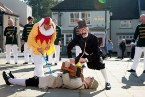 Doctor cures musician, much to delight of dance team. (Photo of Monkseaton Morris Men, taken by Phil Skeates.)