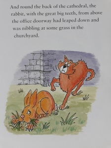 Cartoon of brown rabbit with huge vampire teeth chewing grass.