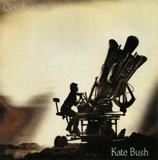 "Album cover of ""Cloudbusting"" by Kate Bush showing the singer and a large trumpet-like machine on a hillside."