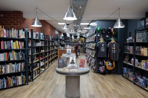 Interior of Travelling Man, York, lots of comic books on shelves and display tables.
