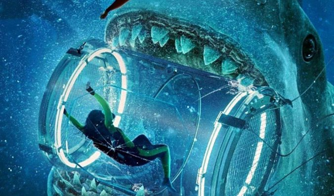 Image of diver inside a see-through shark tank, inside a giant shark's mouth, from the film The Meg