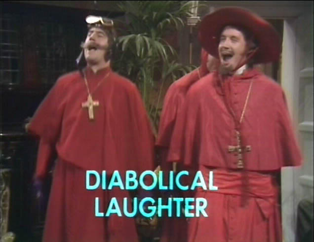 Terry Jones and Michael Palin dressed as the Spanish Inquisition from the famous Monty Python sketch (what do you mean you've not seen it?)